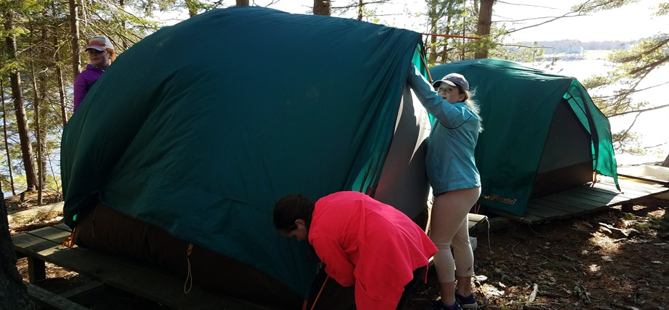 Fifth graders set up tents at Chewonki's Outdoor Classroom.