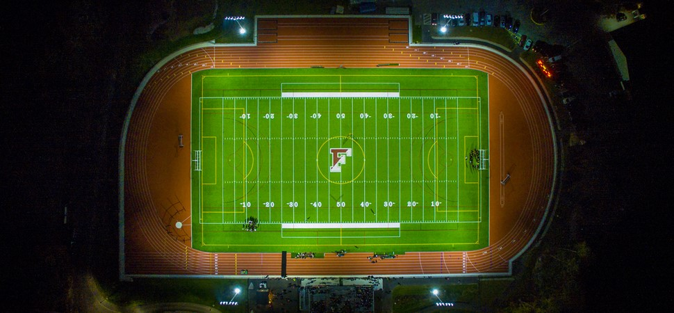 Drone image of FHS field at night