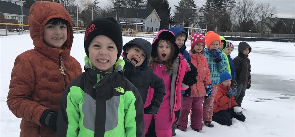 Kindergarten students playing in snow.